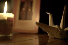 une bougie et une cocotte en papier origami
